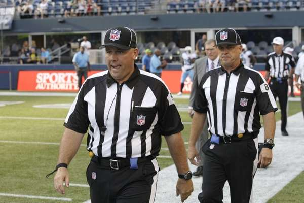 Replacement officials take the field at the start