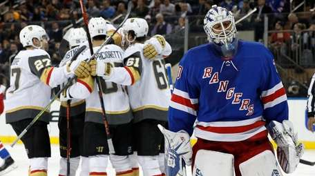 Henrik Lundqvist of the Rangers reacts as Max