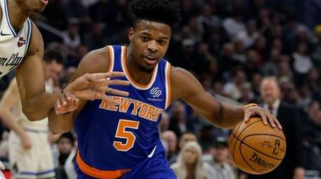The Knicks' Dennis Smith Jr. drives against the