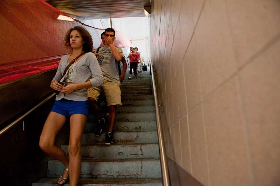 LIRR passengers descend three levels of steps at
