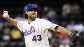 R.A. Dickey pitches during the second inning of