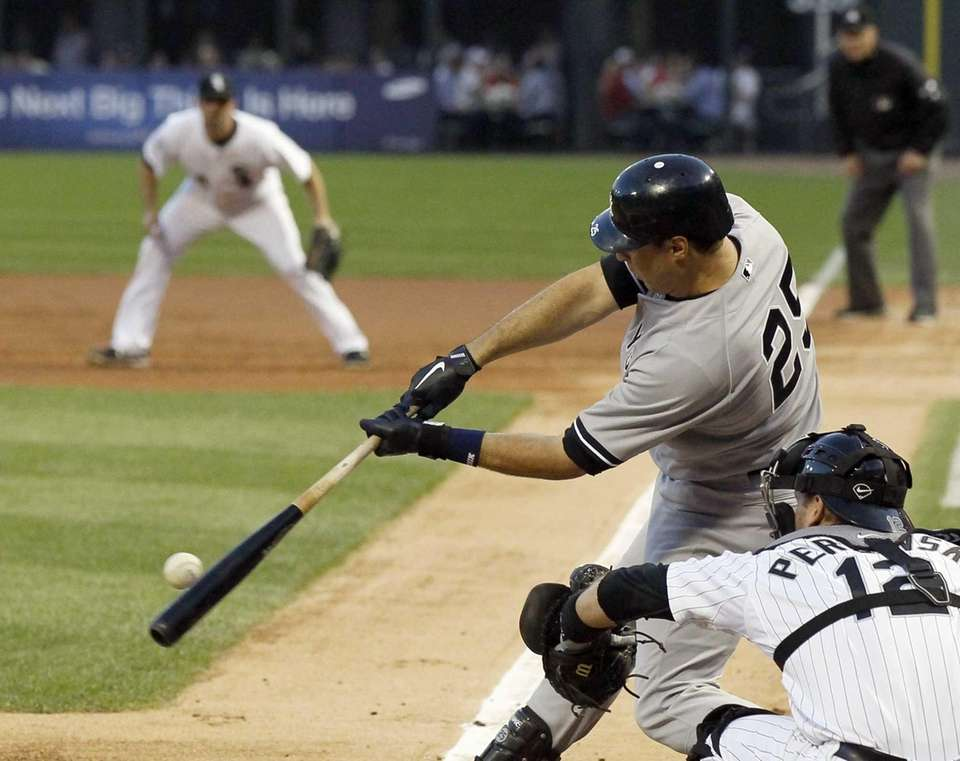New York Yankees' Mark Teixeira hits an RBI