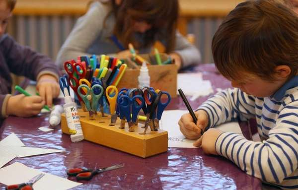 Children do handicrafts at a day care center