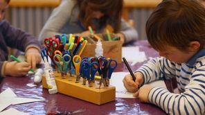Children do handicrafts at a day care center