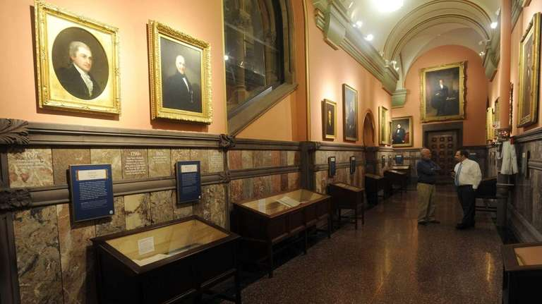 Display cases filled with historic documents and painted
