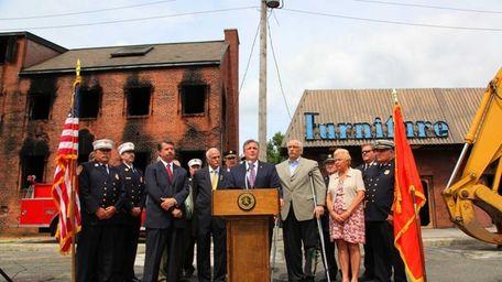 Nassau County Executive Edward Mangano, center, announces the