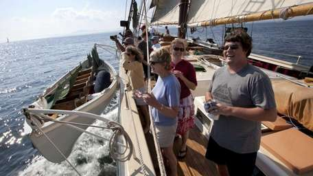 Passengers on the Mary Day gather as they