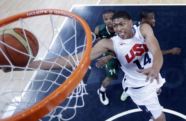 Team USA's Anthony Davis (14) scores against Nigeria