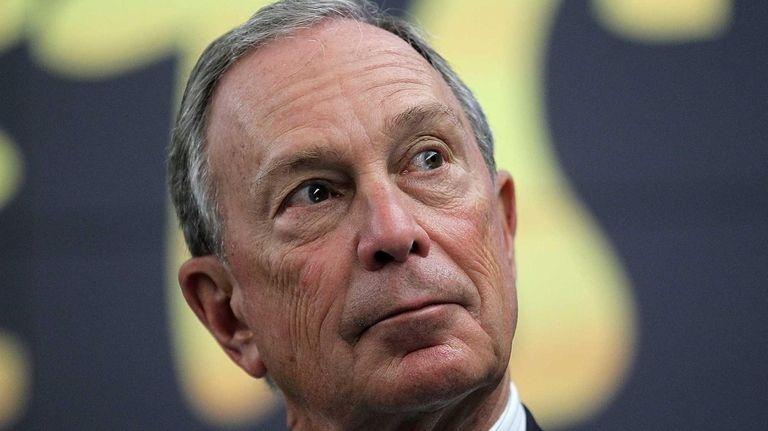 New York City Mayor Michael Bloomberg looks on