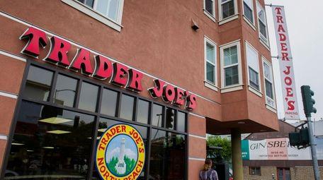 A pedestrian walks past a Trader Joe's location