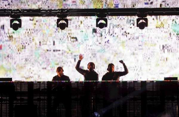 DJ group Swedish House Mafia onstage during the