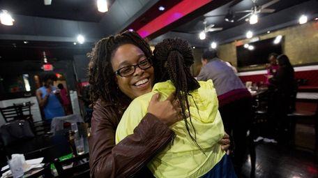 Kisha Jones, of Inwood, left, and Natasha Parker,
