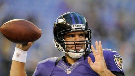 Ravens quarterback Joe Flacco warms up before a