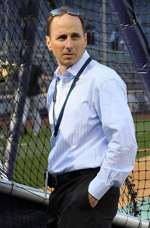 Brian Cashman looks on during batting practice before