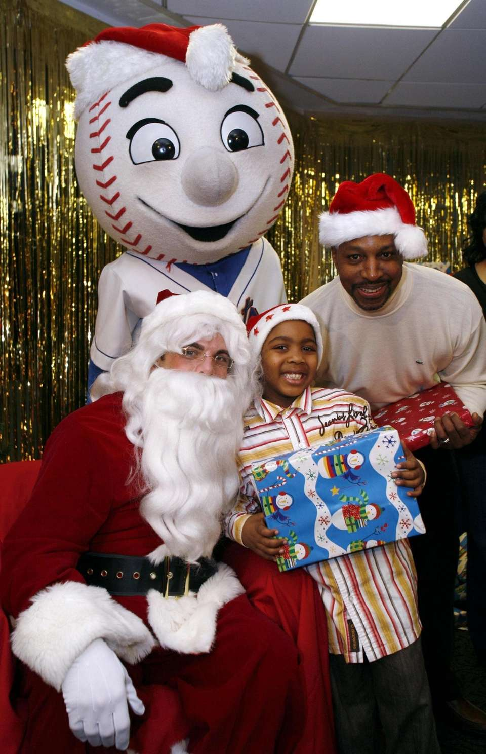 David Wright dresses as Santa Claus at the