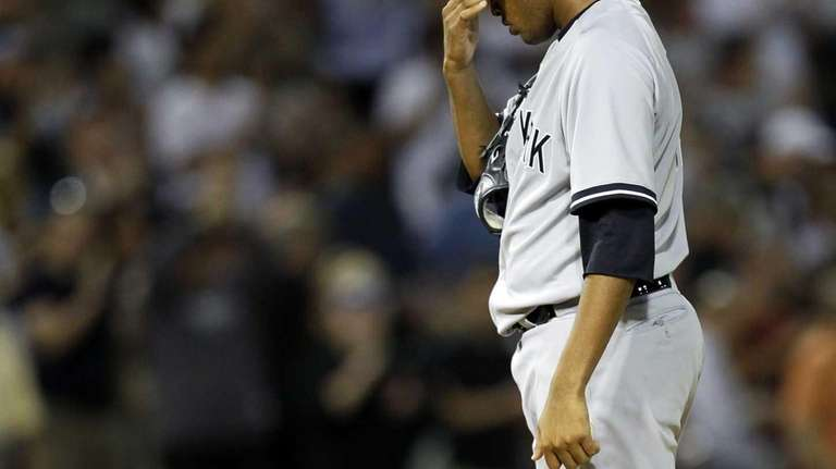 Ivan Nova reacts after giving up a home