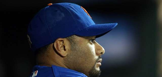 Johan Santana looks on from the dugout against