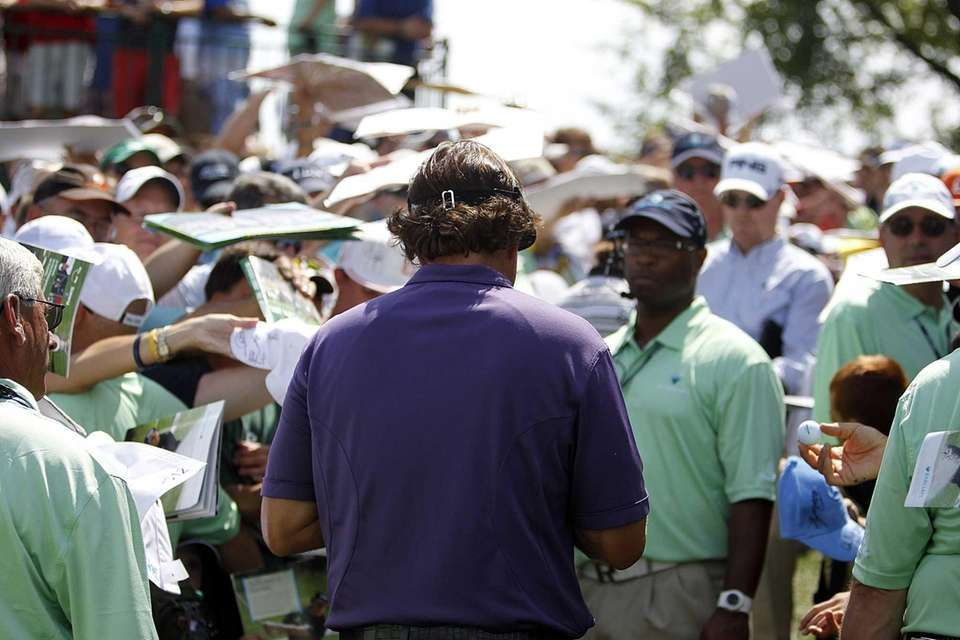 Phil Mickelson signs autographs for enthusiastic fans during