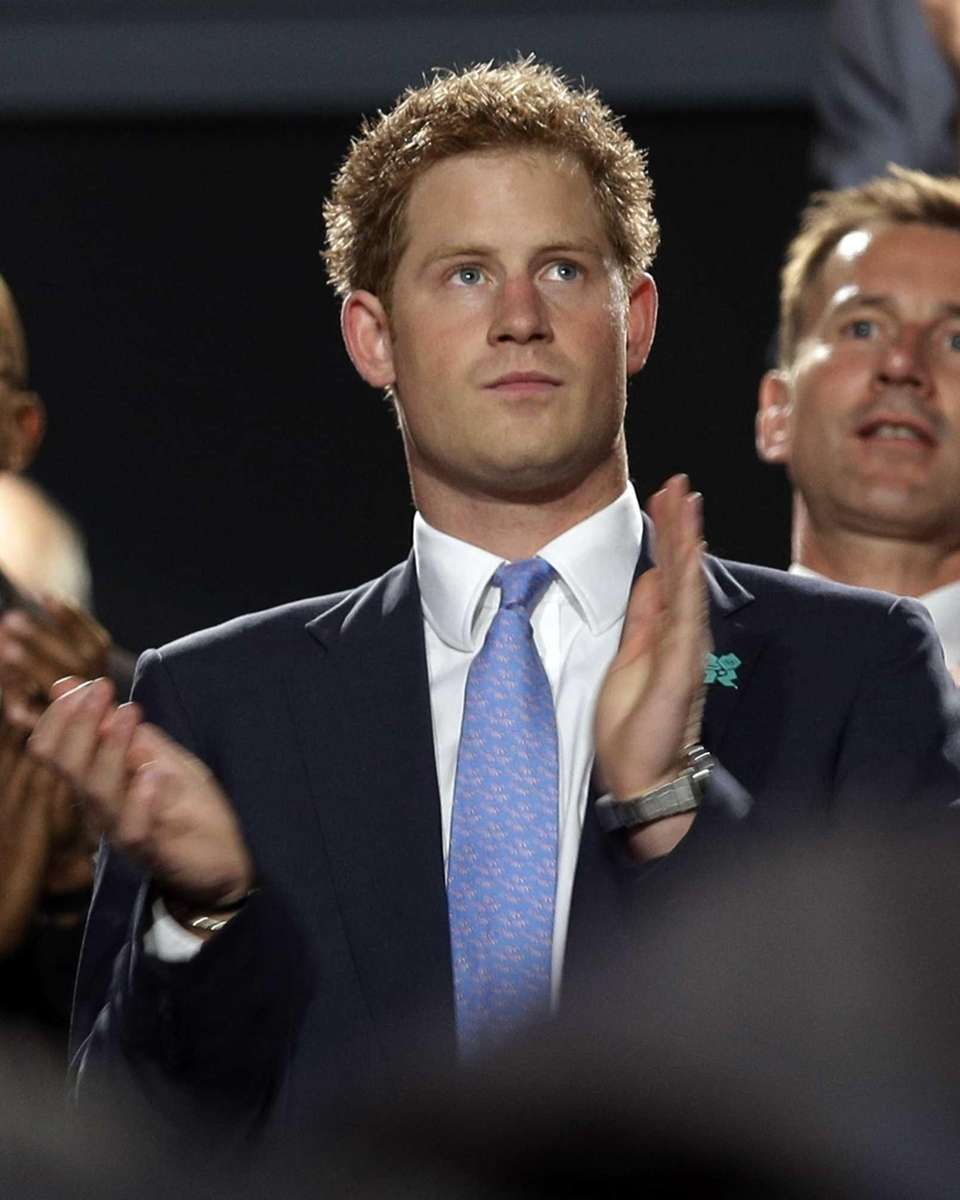 Prince Harry applauds during the closing ceremony of