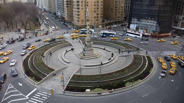 Traffic rounds Manhattan's Columbus Circle and its 70-foot-tall