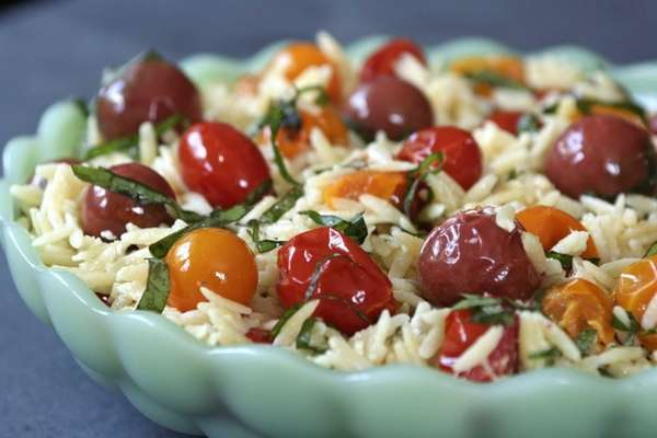 Cherry and grape tomatoes are briefly roasted and