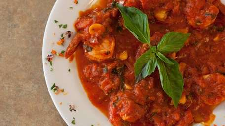 Umberto's vibrant shrimp fra diavolo is served with