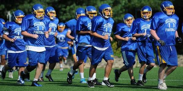 Kellenberg players jog to condition themselves during varsity