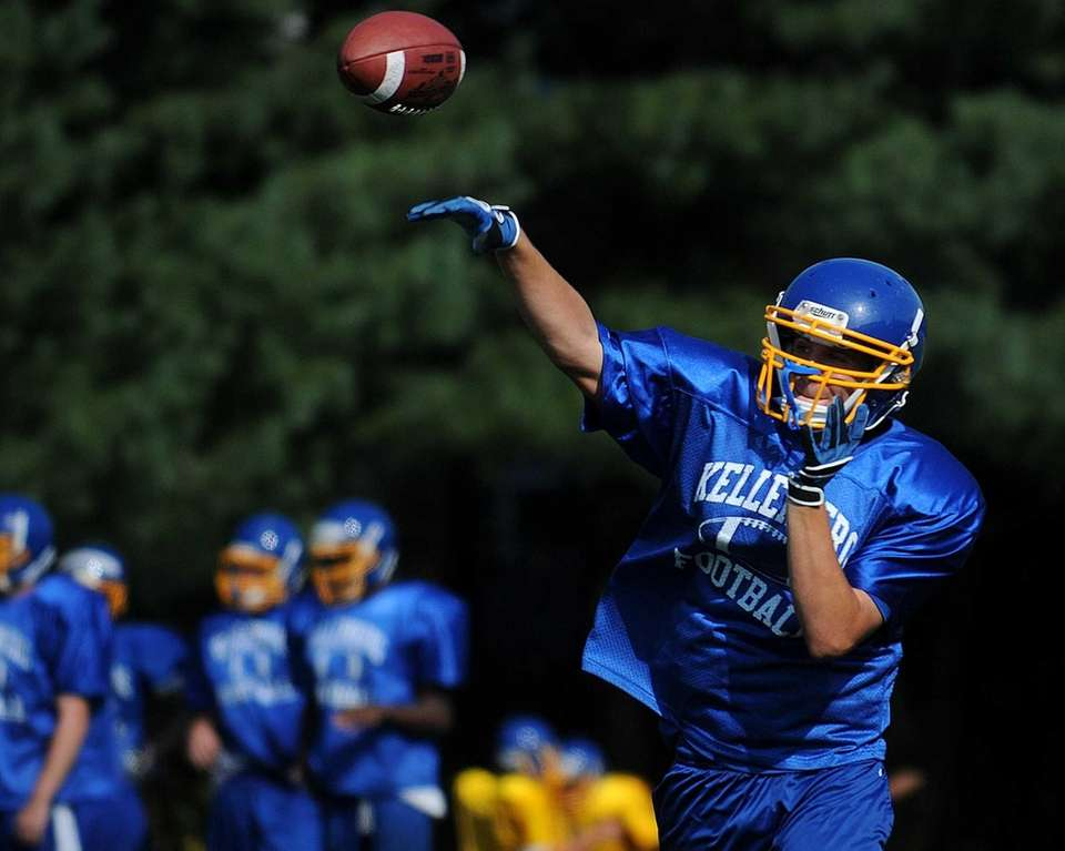 Kellenberg's Kyle Driscoll throws a pass during training