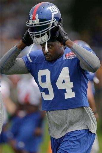 Mathias Kiwanuka dons his helmet during a workout