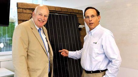 Leviton exec Jay Sherman, right, with spokesman David