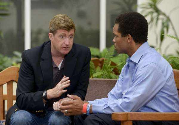 Former U.S. Rep. Patrick J. Kennedy, left, meets