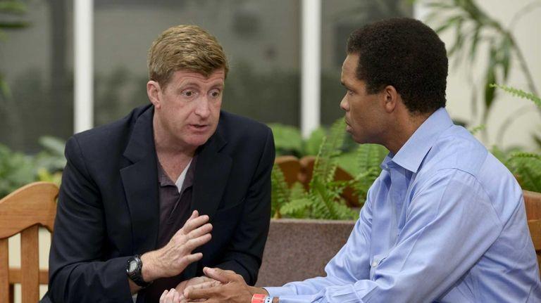 Former U.S. Rep. Patrick J. Kennedy, left, meets