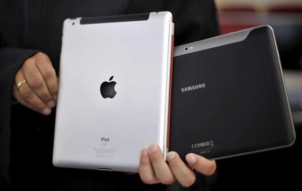 An attorney holds an Apple iPad, left, and