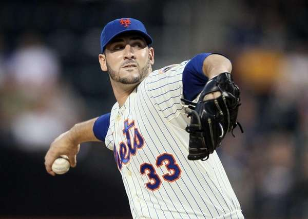 Matt Harvey pitches against the Colorado Rockies at