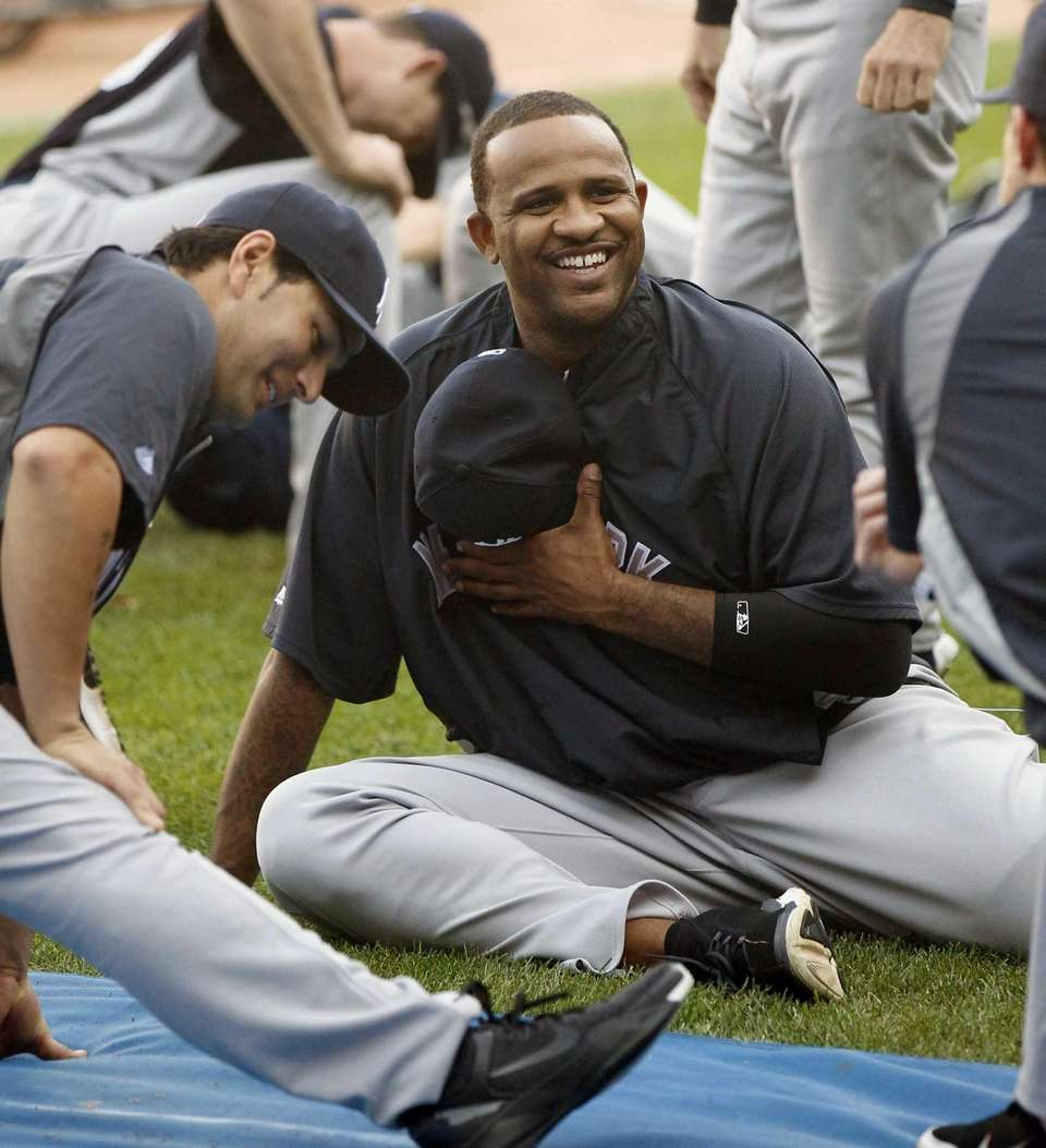 CC Sabathia, right, smiles as he stretches with