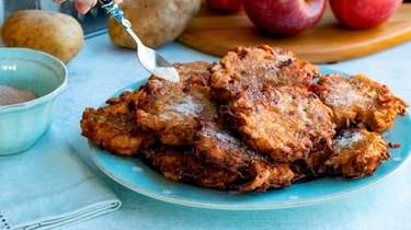 Apple-potato latkes are topped with cinnamon sugar.