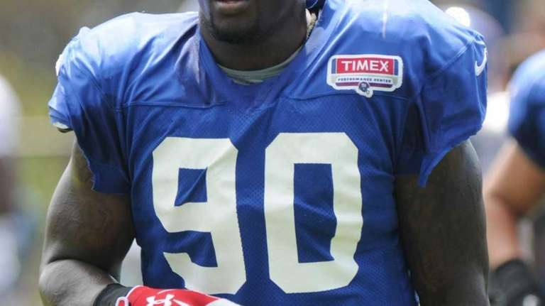 Jason Pierre-Paul walks off the field during training