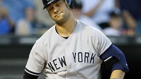 Nick Swisher reacts after striking out during a