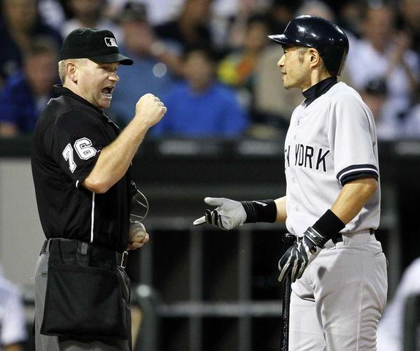Ichiro Suzuki argues with home plate umpire Mike