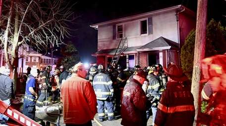 Firefighters at the scene early Wednesday morning in