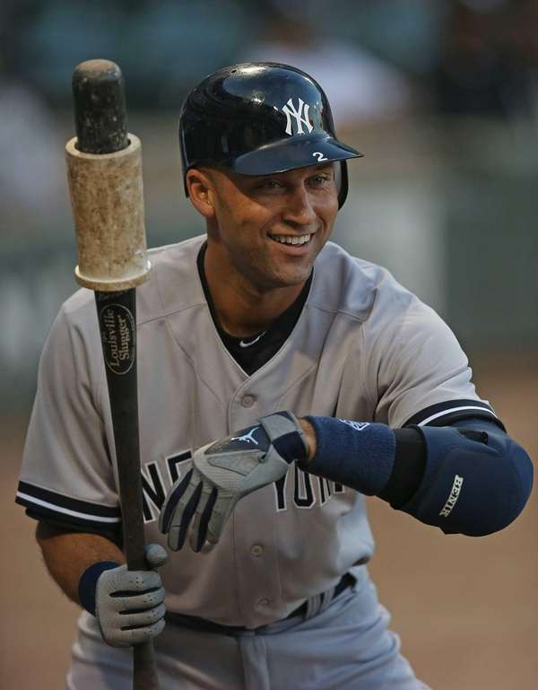 Derek Jeter smiles before hitting the first pitch