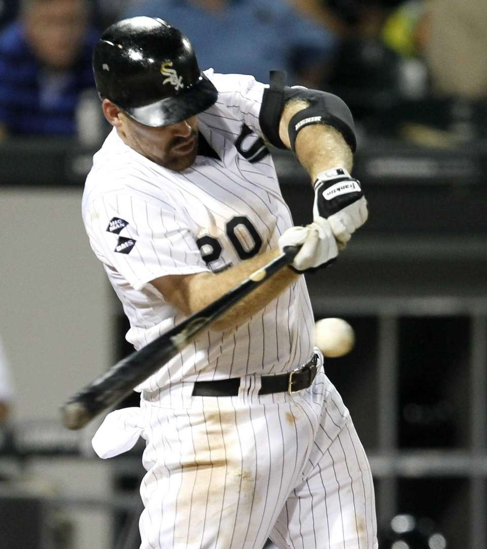 The Chicago White Sox's Kevin Youkilis hits a