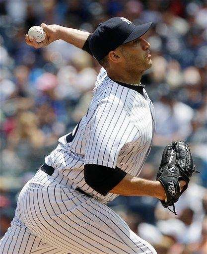 Andy Pettitte delivers a pitch during the first