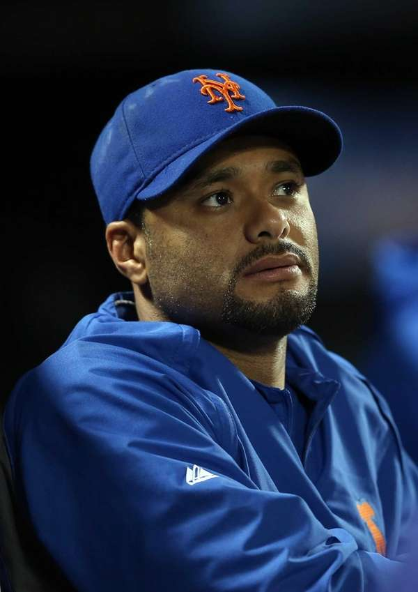 Johan Santana looks on from the dugout during