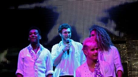 Joshua Ledet, left, Phillip Phillips, center, Colton Dixon,