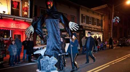 """Giant puppets depicting the ghosts in """"A Christmas"""