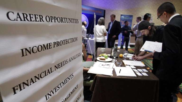 Job seekers visit a Primerica booth at a