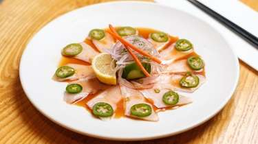 Yellow tail sashimi with soy sauce and jalapeno