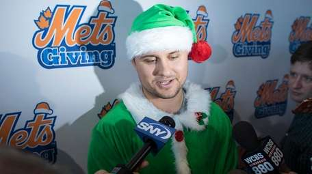 The Mets' J.D. Davis, dressed as an elf,