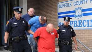 Michael D'Alessandro, 43, of East Patchogue, in front,
